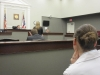 Simone listens to Trevor\'s testimony